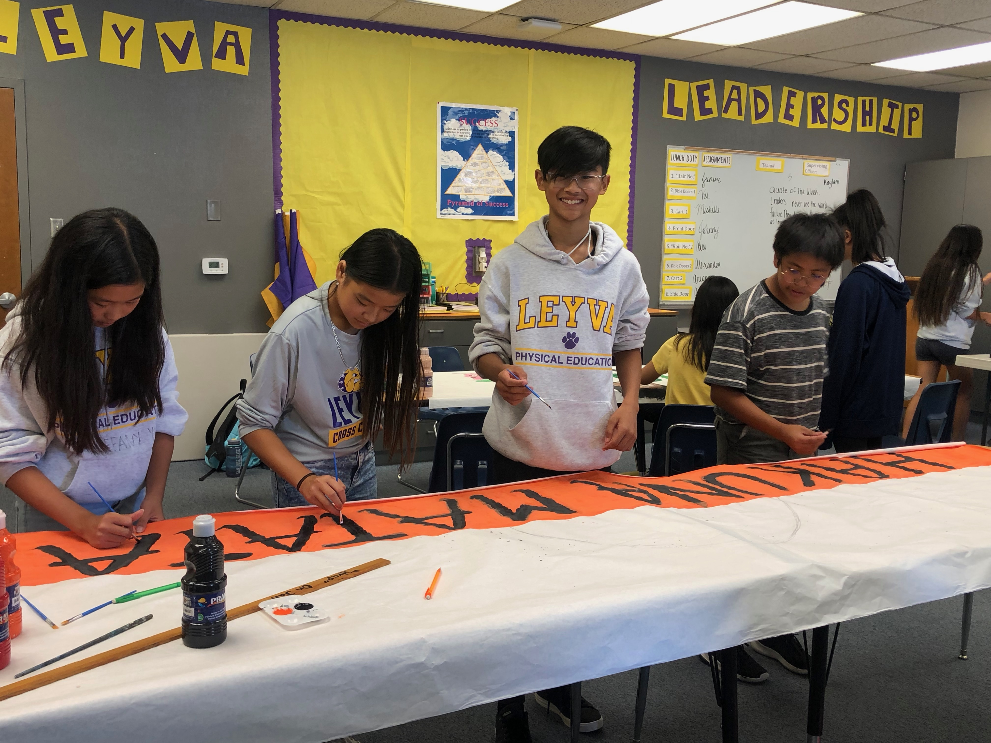 students paining a poster